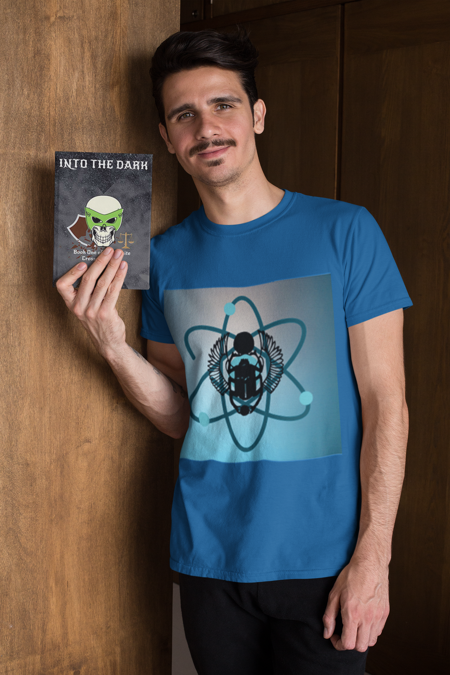 t-shirt-mockup-of-a-man-holding-a-book-while-leaning-on-a-wooden-door-28499